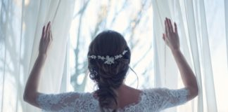 bride-opening-curtains-wedding-morning