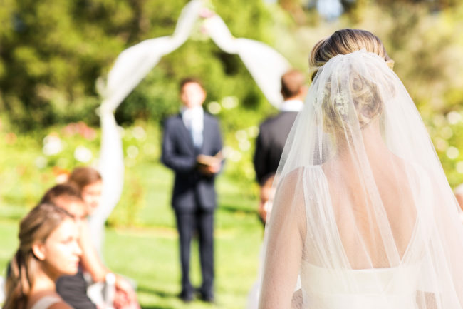 bride walking aisle the A-Z of British Wedding Traditions and Etiquette