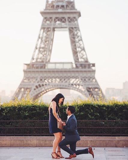 Eiffel Tower proposal Paris couple getting engaged