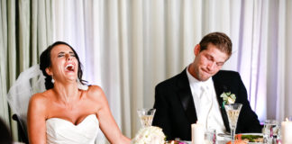 Bride and groom laughing funny wedding speeches