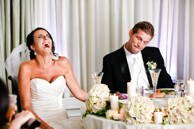 Bride and groom laughing 5 Real Wedding Speeches to Make Your Guests Laugh
