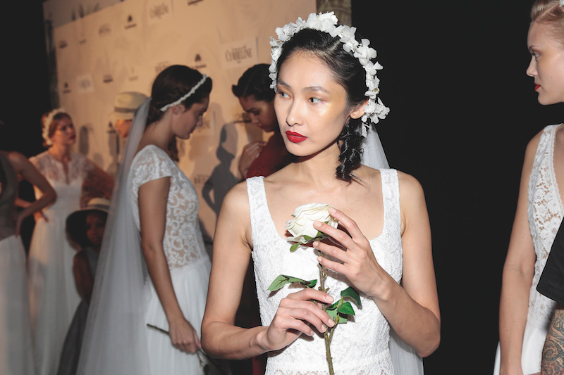 cymbeline catwalk show 2019 wedding trend bride wearing red lipstick