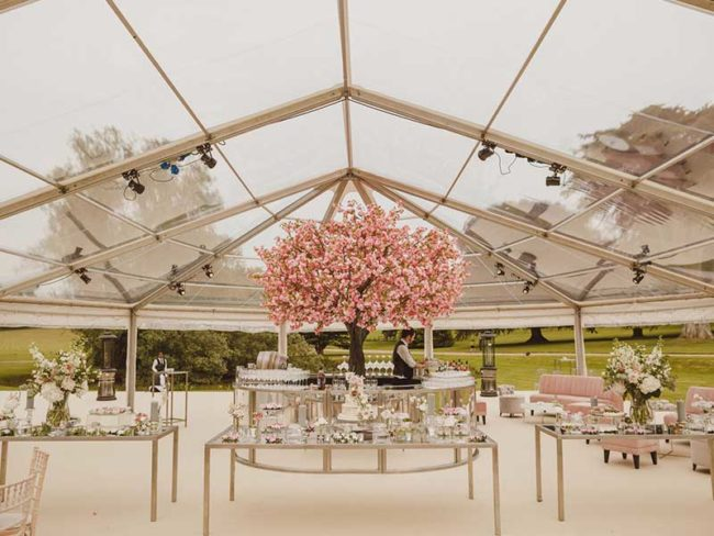 cherry blossom centered in a wraparound bar dressing your wedding venue with artificial trees