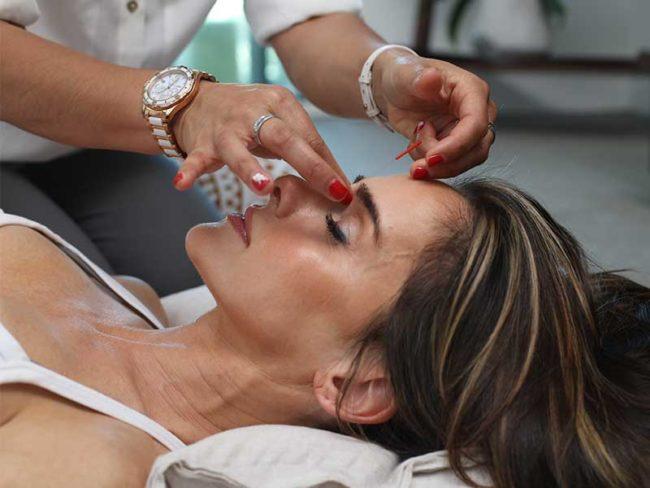 woman having facial wedding beauty treatments