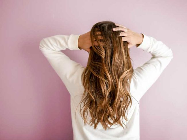running hands through hair- olaplaex treatment