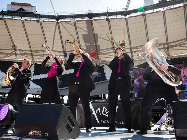 five piece brass band performing in a stadium wedding entertainment