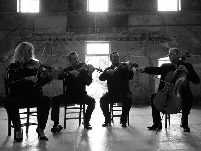 Status cymbal string quartet playing black and white