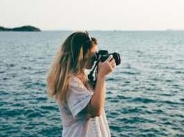 girl taking photo instagram holiday destinations