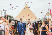 Wedding Festival Bride and groom in front of tent