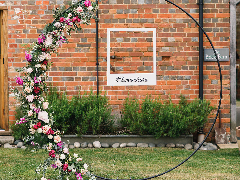 Floral hoop photobooth Styling a Barn Venue for Your Wedding Day