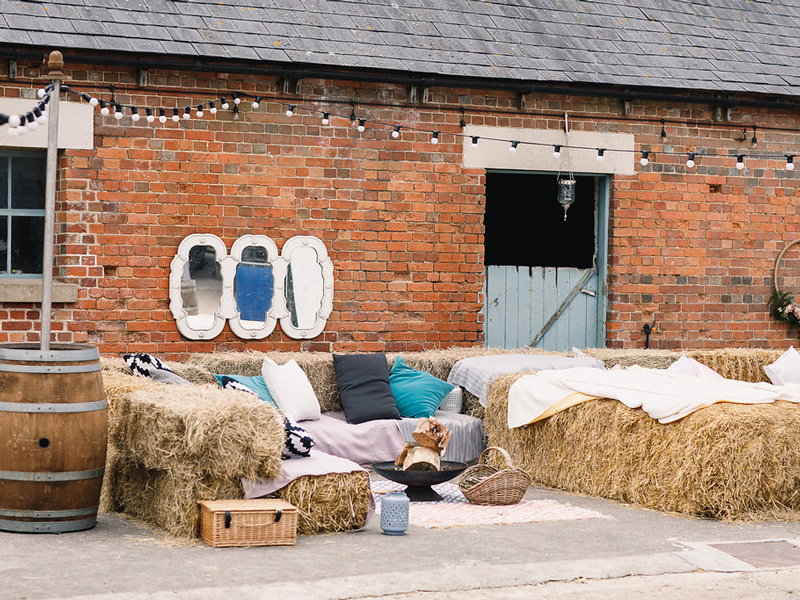 Farm barn seating hay bales Styling a Barn Venue for Your Wedding Day