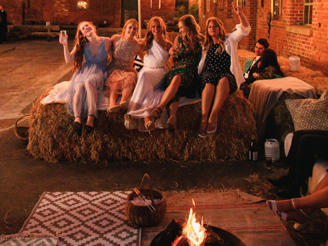 Evening wedding guests fire pit Styling a Barn Venue for Your Wedding Day